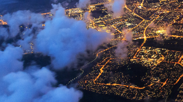 Photo of city lights from above.
